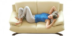 women on couch tired