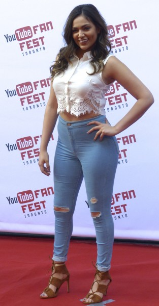 Bethany Mota posing on the red carpet