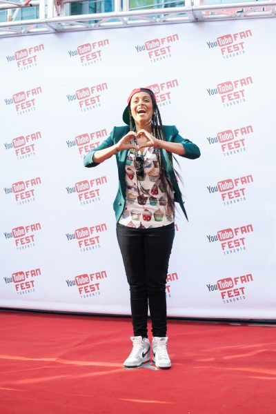 Lilly Singh of IISuperwomanII on the YouTube FanFest red carpet
