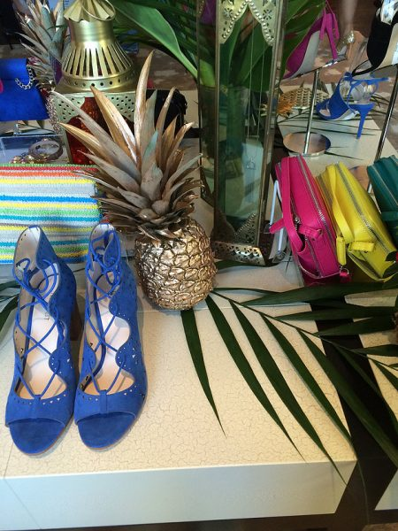 Bright heels and palm leaves